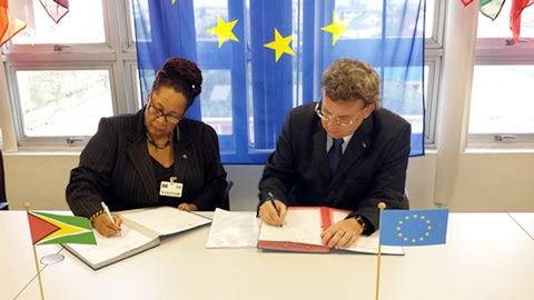 Ambassador Robert Kopecký, Head of the European Union Delegation in Guyana, and Ms. Margaret Lawrence, Executive Director of Merundoi Incorporated sign a grant contract to implement a two year (2 yr) project entitled